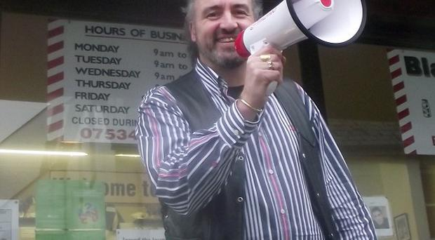 Barber Andy Blackwell from Liskeard in Cornwall was 'blacklisted' by the local authority for using a megaphone to alert motorists to traffic wardens