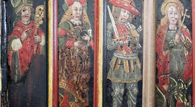 Thieves hacked the two panels, depicting St Victor of Marseilles and St Margaret, from their casings, as well as smashing a gaping hole in a third