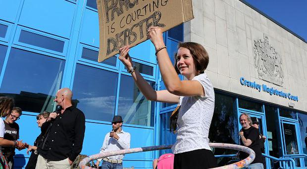 Anti-fracking activist Katie Fairweather protests outside Crawley Magistrates' Court as protesters appear on charges over demonstrations at the Cuadrilla drilling site in Balcombe