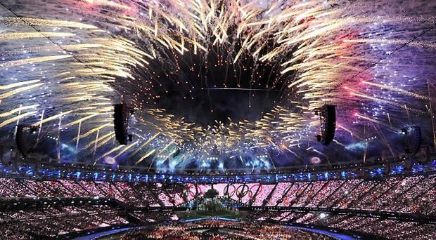 British stuntman Mark Sutton parachuted into the Olympic Stadium dressed as James Bond during the London 2012 opening ceremony