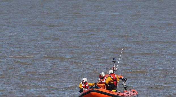 A coastguard rescue team, lifeboat and helicopter are searching for two boys who have gone missing