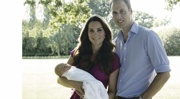 The Duke and Duchess with their son Prince George in the garden of the Middleton family home in Bucklebury, Berkshire