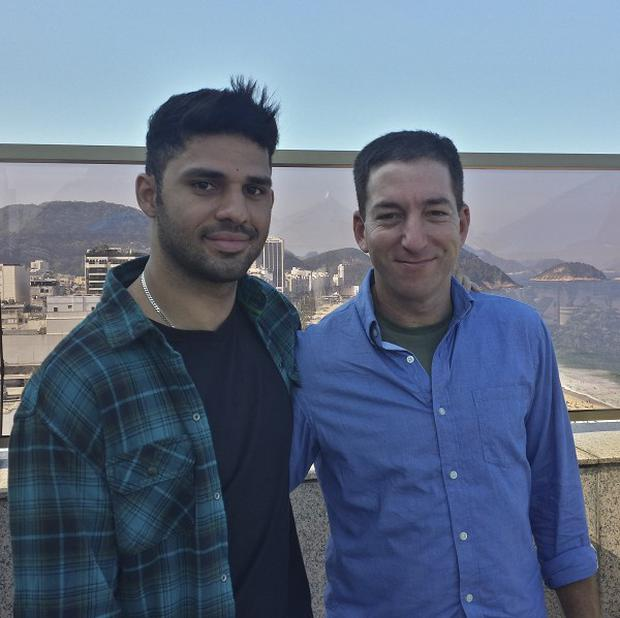Guardian journalist Glenn Greenwald, right, and his partner David Miranda (AP/Janine Gibson, The Guardian)