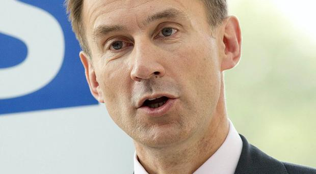 Health Secretary Jeremy Hunt said a change of attitude was needed towards working carers