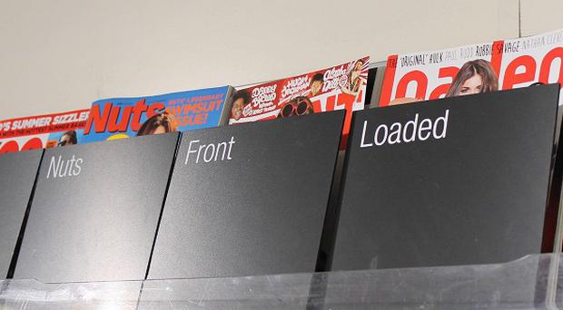 The Co-operative Group have told lads' mags to cover up with 'modesty bags'