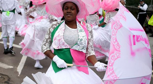 Dancers from Kinetika Bloco take part in the Notting Hill Carnival in west London