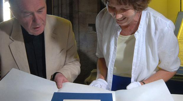 Archivist Rosalind Caird, right, and Chancellor Canon Chris Pullin with the King's Writ, front, and the Magna Carta at Hereford Cathedral (Hereford Cathedral Perpetual Trust)