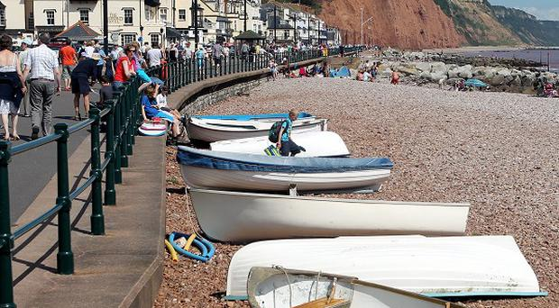 An investment banker who spent most of his holidays in Sidmouth admiring its beach, blooms and Regency architecture left the town £2.3 million