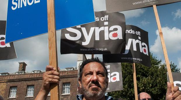 Protesters demonstrating against military action in Syria