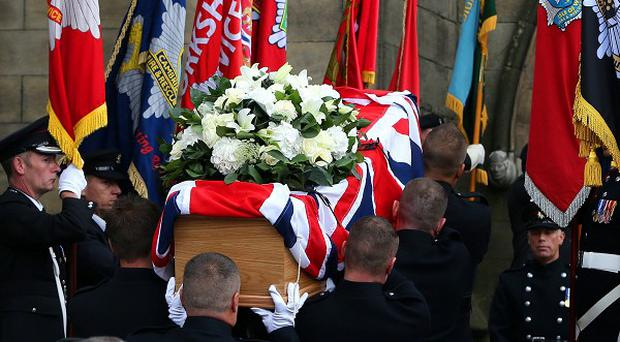 The coffin is carried into Bury Parish Church, Greater Manchester, during the funeral of Stephen Hunt