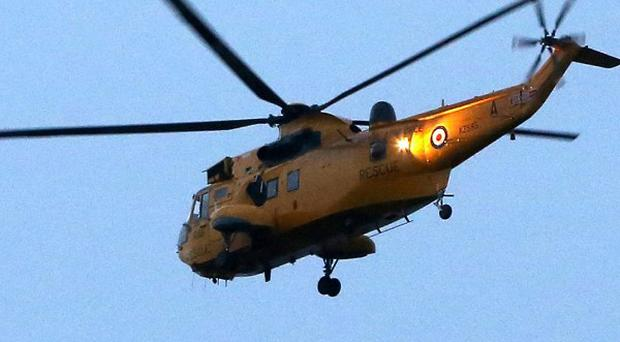 A UK rescue helicopter is assisting in a search-and-rescue operation after a light aircraft ditched in the sea off Jersey