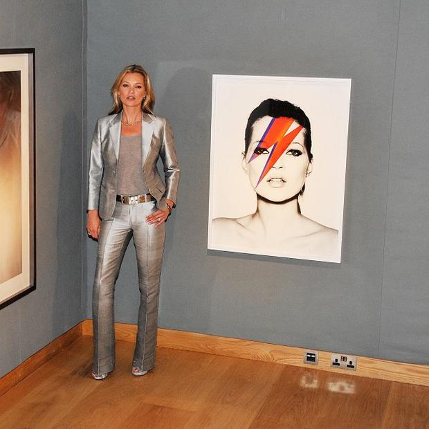 Model Kate Moss poses during a preview of Christie's forthcoming Kate Moss From The Collection of Gert Elfering sale
