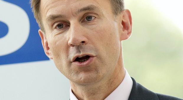 Health Secretary Jeremy Hunt said abortion on the grounds of gender selection was 'against the law and completely unacceptable'