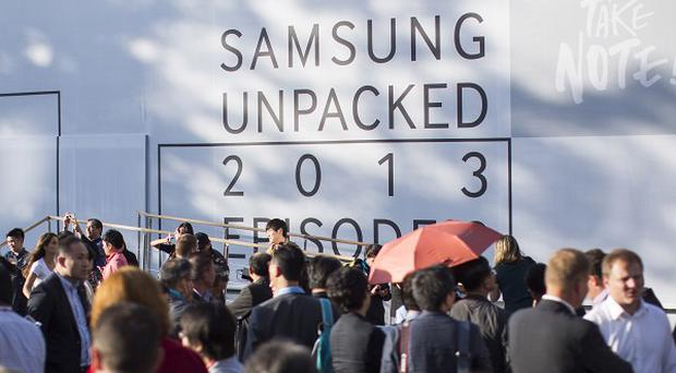 People queue before a Samsung product presentation in Berlin, Germany (AP)