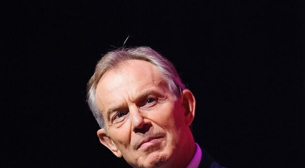 Former prime minister Tony Blair has attacked Ed Miliband's stance on the Syrian crisis