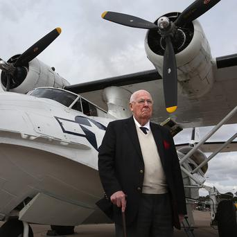 VC recipient John Cruickshank gets ready for his flight in a Catalina seaplane