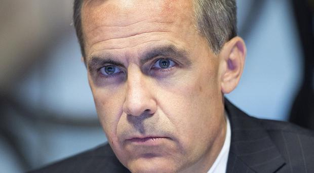 Mark Carney has tied the unemployment level to interest rates