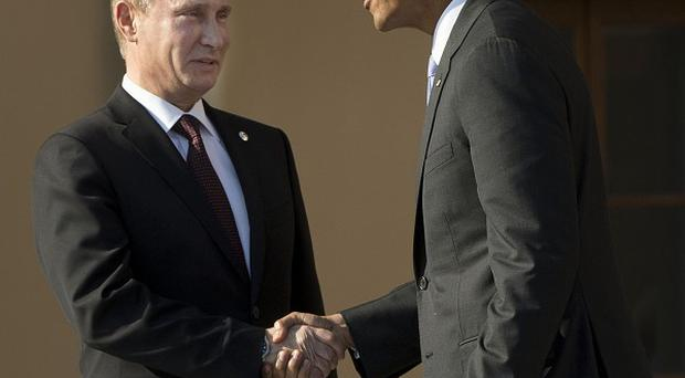 Barack Obama and Vladimir Putin are among members of the UN Security Council meeting to discuss how to deal with Syria's chemical weapons (AP/Pablo Martinez Monsivais)