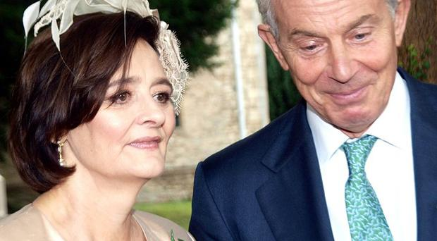Former Prime Minister Tony Blair with wife Cherie Blair