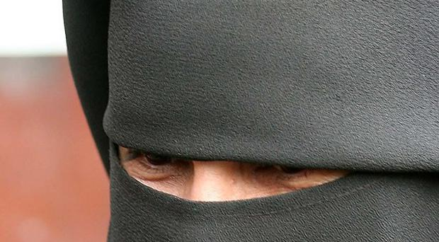 A judge has ruled on the wearing of a full-face veil in court