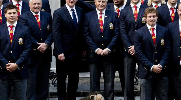 England centre Manu Tuilagi stuck his fingers above David Cameron's head to give him 'bunny ears' during a photo shoot (Chris Harris/The Times/PA)
