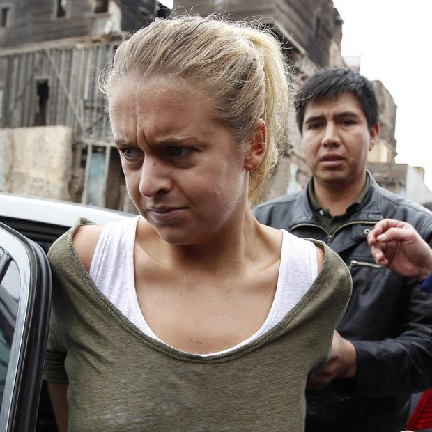Melissa Reid claims she and another woman were forced to carry cocaine by an armed gang who threatened them and their family members (AP)