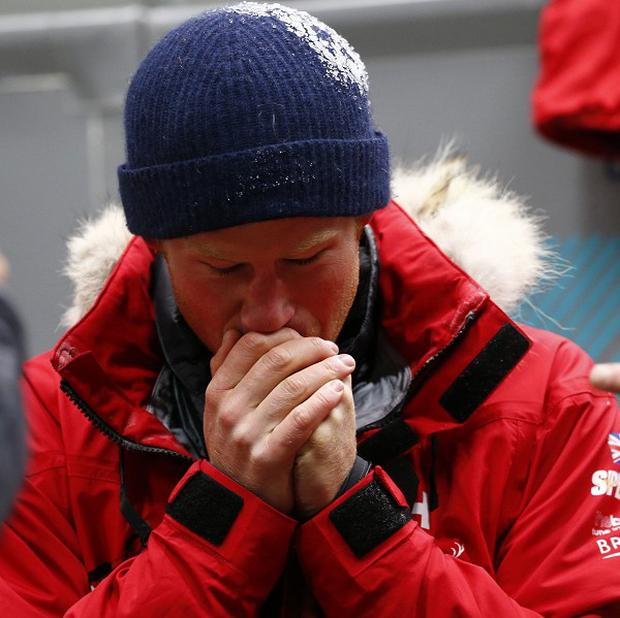 Prince Harry warms his hands after a cold chamber training exercise with the Walking with the Wounded South Pole Allied Challenge 2013 British team at the MIRA environmental test chamber in Nuneaton (Darren Staples/Reuters/PA)