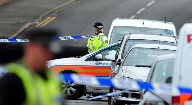 Police at the scene in Kent Street, Leicester