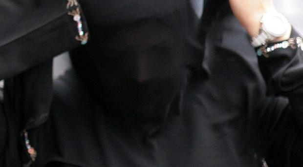 The health minister has claimed face coverings such as veils and burkas can be a barrier to good communication between health care professionals and patients