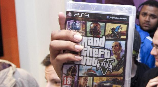 The 23-year-old victim was attacked as he made his way home from a midnight launch event for the game