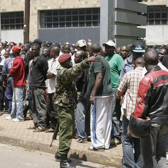 Security officers keep a crowd under control outside the Westgate Mall, an upscale shopping centre in Nairobi (AP)
