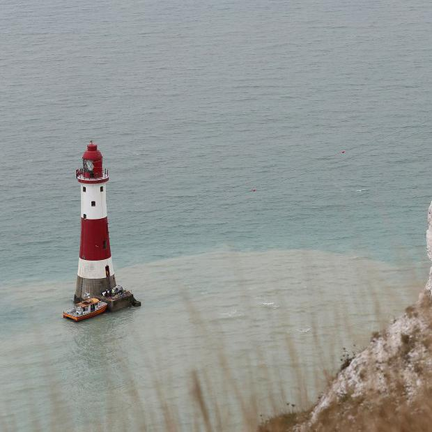Paint and equipment is brought by boat to Beachy Head Lighthouse near Eastbourne