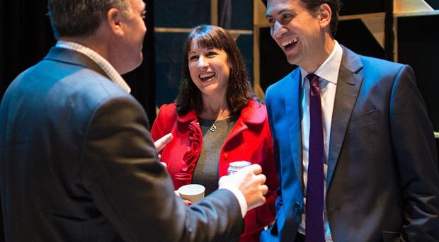 Labour leader Ed Miliband chats with shadow chancellor Ed Balls and shadow chief secretary to the Treasury Rachel Reeves