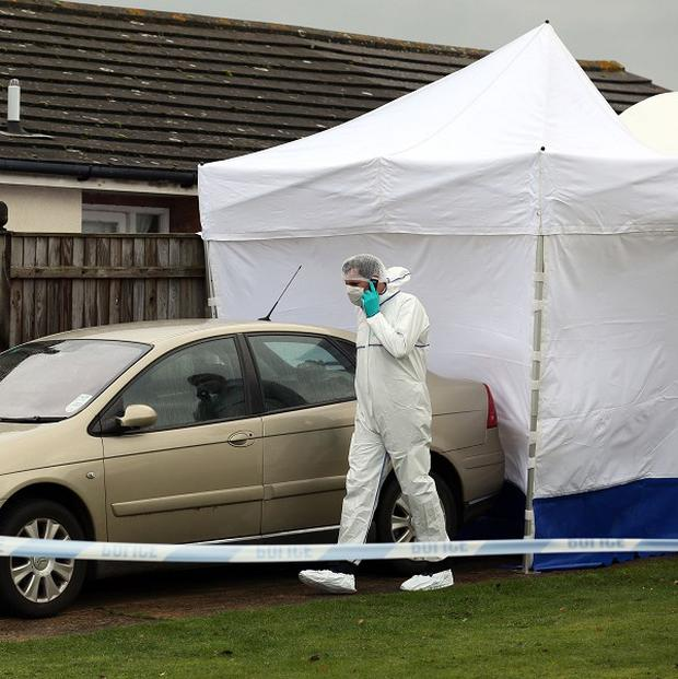 Police at the scene in Norfolk following the deaths of Keith Johnson and his wife Andrea