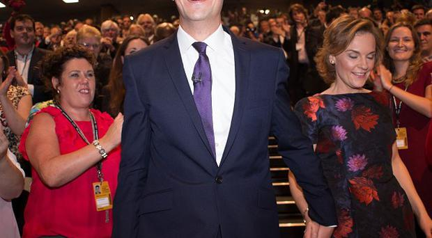 Labour leader Ed Miliband, accompanied by his wife Justine, is applauded following his keynote speech