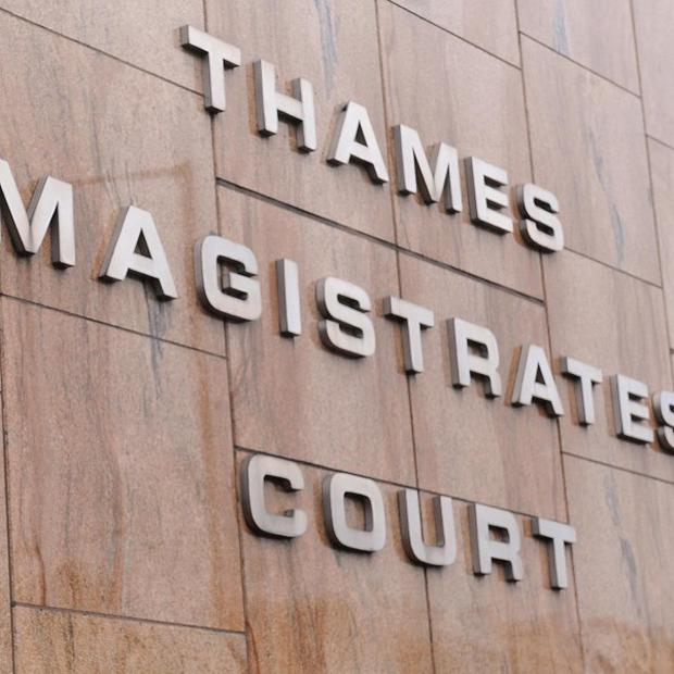Two men failed to appear at Thames Magistrates' Court and were found guilty in their absence after being prosecuted for spitting