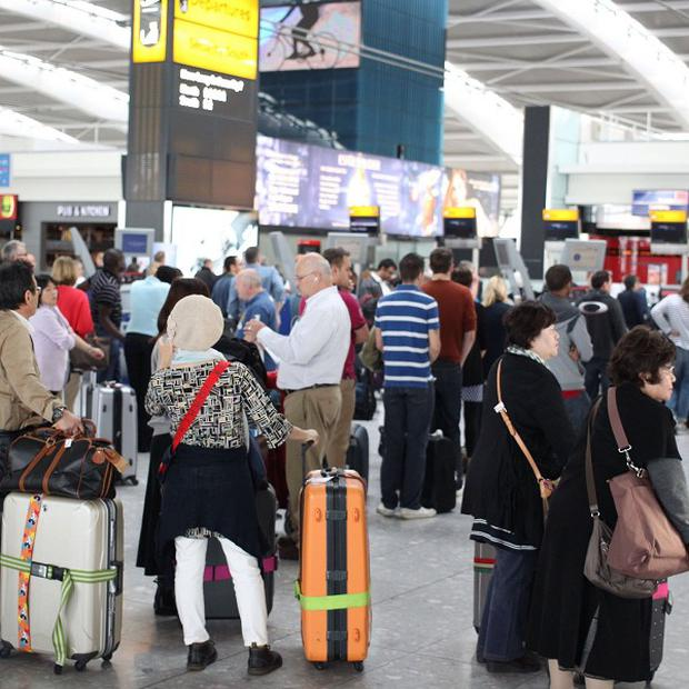 Queues form as British Airways passengers with check-in luggage were unable to fly from Heathrow's Terminal 5 due to a computer problem