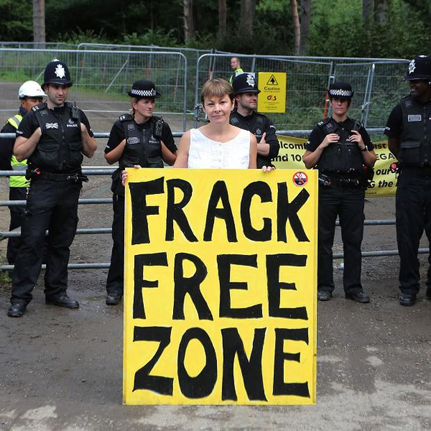Caroline Lucas stands at the main entrance to the Cuadrilla site in Balcombe, West Sussex