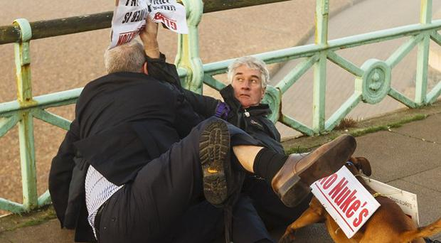 Iain Dale, political blogger and publisher, scuffling with protestor Stuart Holmes