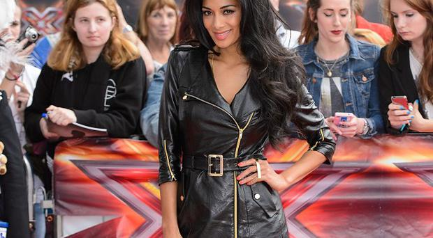 Tears are shed as Nicole Scherzinger makes hard choices for her X Factor line-up.