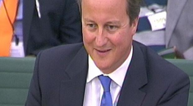 Prime Minister David Cameron has been urged to scrap controversial work assessments for the disabled