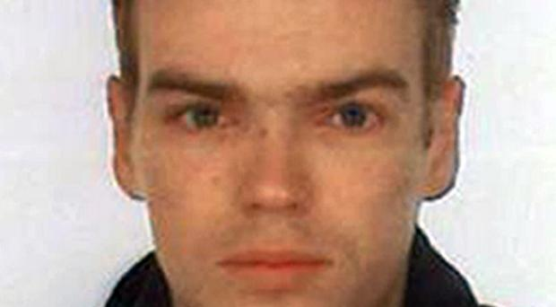 A murder investigation was launched after the body of a Lithuanian man was found in a stream.