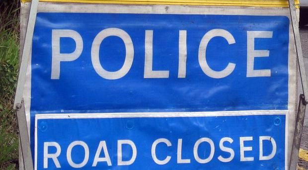 South Wales Police have appealed for witnesses after a man died in Bridgend when his car crashed into a shop