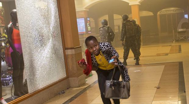 Kenyan officials have arrested 12 people in connection with the attack at the Westgate Mall in Nairobi (AP)