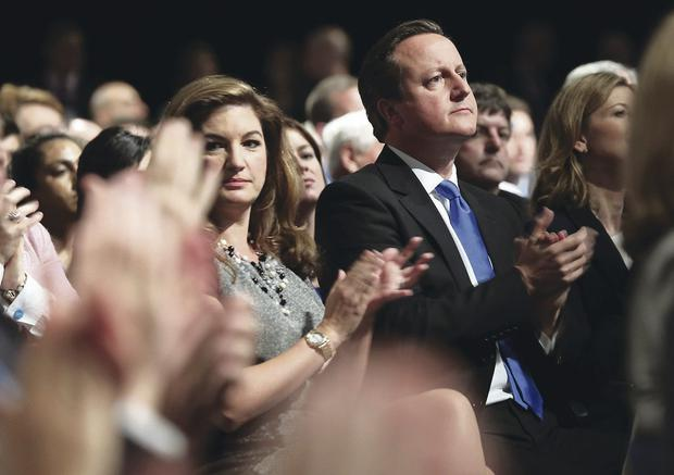 Prime Minister David Cameron and businesswoman Karren Brady applaud George Osborne's speech at the Tory party conference