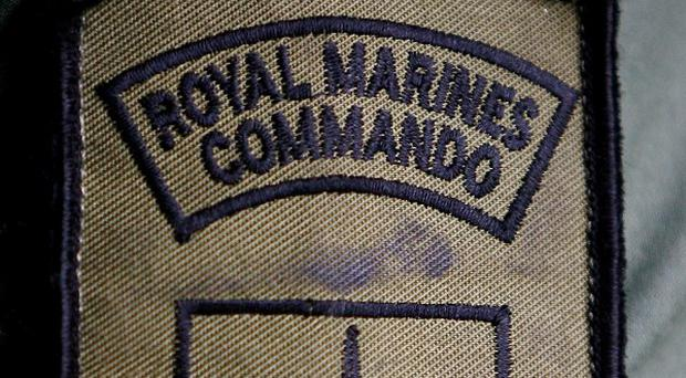 The badge of a Royal Marine Commando, who is taking part in rehearsal exercises above Chatham Maritime Museum in Chatham, Kent, ahead of tomorrow's National Armed Forces Day to be held at the site.
