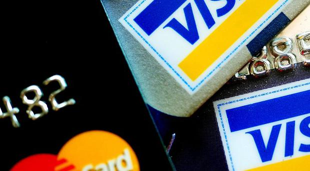 Embargoed to 0001 Wednesday July 3. File photo dated 7/03/13 of credit cards as credit and debit card spending will almost double over the next decade as people increasingly rely on their plastic as a convenient way to pay, an industry report predicts.
