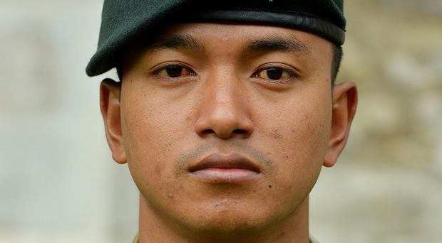 Acting Lance Corporal Tuljung Gurung, from The Royal Gurkha Rifles, is awarded the Military Cross for his gallantry and courage after taking on an insurgent who mounted an attack on the patrol base where he was on guard