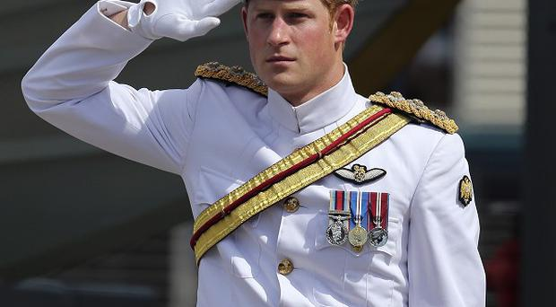 Prince Harry receives a royal salute at Garden Island Naval base in Sydney (AP)