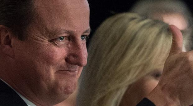 Prime Minister David Cameron has defended 'snooping' safeguards on intelligence agencies.